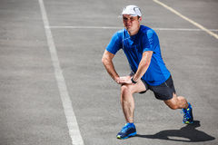 Male runner stretching before royalty free stock photos