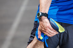 Male runner stretching Stock Image