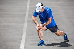 Male runner stretching. Male runner stretching before workout Stock Photos