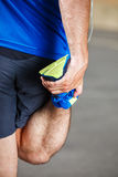 Male runner stretching. Before workout Royalty Free Stock Photo