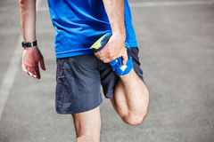 Male runner stretching Stock Photo