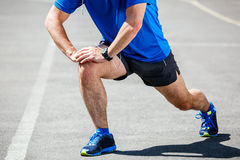 Male runner stretching. Before workout Stock Images