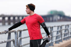 Male runner training in cold winter doing warm-up Royalty Free Stock Photo