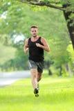 Male runner training for marathon Royalty Free Stock Image