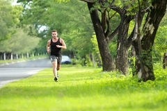 Male runner training for marathon Stock Photo