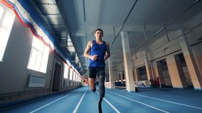 Male runner training with a prosthesis, bionic leg. 4K stock video footage