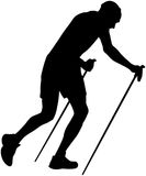 Male runner with trekking poles Stock Photo