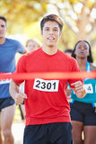 Male Runner Winning Marathon Stock Images