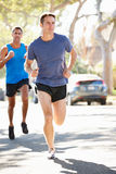 Male Runners Exercising On Suburban Street Royalty Free Stock Image