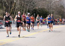 Male runners races up the Heartbreak Hill during the Boston Marathon April 18, 2016 in Boston. Royalty Free Stock Photo