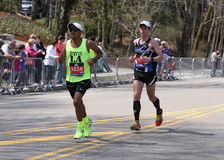 Male runners races up the Heartbreak Hill during the Boston Marathon April 18, 2016 in Boston. Stock Photo