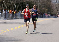 Male runners races up the Heartbreak Hill during the Boston Marathon April 18, 2016 in Boston. BOSTON - APRIL 18: male runners races up the Heartbreak Hill Royalty Free Stock Images