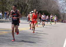 Male runners races up the Heartbreak Hill during the Boston Marathon April 18, 2016 in Boston. Royalty Free Stock Image