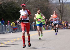 Male runners races up the Heartbreak Hill during the Boston Marathon April 18, 2016 in Boston. Royalty Free Stock Photos