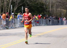 Male runners races up the Heartbreak Hill during the Boston Marathon April 18, 2016 in Boston. Stock Image