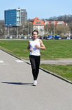 Male running around the city. Athletic young male running around the city Stock Photo