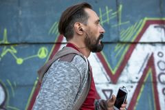 Male running and listening to music on cell phone. Stock Images