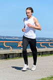 Male running on the shoreline Stock Photo