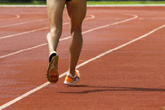 Male running at a track Stock Photos