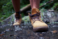 Male`s boots with drops of water Stock Photos