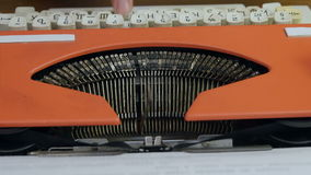 Male`s fingers typing on vintage red typing machine. Close up shot. Top view. Professional shot on Lumix GH4 in 4K resolution. You can use it e.g. in your stock footage