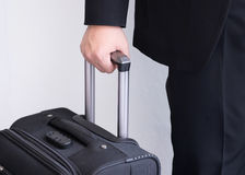 Male's hand hold baggage for travelling Royalty Free Stock Image
