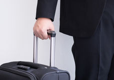 Male's hand hold baggage for travelling. Male's hand hold baggage for business travelling Stock Image