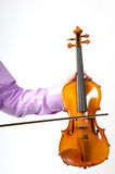 Male's hand holding violin Royalty Free Stock Photography