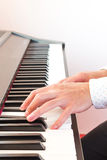 Male's hand playing piano. Closeup male's hand playing piano Stock Photos
