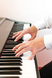 Male's hand playing piano. Closeup male's hand playing piano Stock Photo