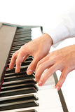 Male's hand playing piano. Closeup male's hand playing piano. On white isolate background Royalty Free Stock Photo