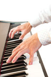 Male's hand playing piano. Closeup male's hand playing piano on white isolate background Royalty Free Stock Photography