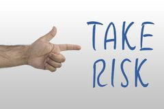 Male`s hand showing to Take Risk. Taking risk, danger chance concept. Male`s hand showing to Take Risk. Taking risk, danger chance concept royalty free stock images