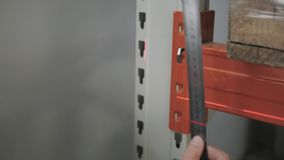 Male`s Hands With Precision Measuring Tool. Engineer Makes Measurement of The Beam At The Storage, Close Up Shot stock video footage