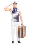 Male sailor saluting towards the camera Royalty Free Stock Photography