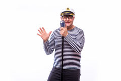 Male sailor singer on microphone. On white back Stock Photo