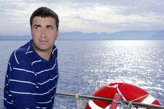 Male sailorman on blue sea boat. Looking ocean horizon Stock Images