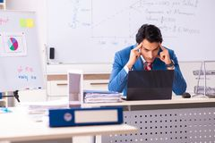 The male sales analyst in front of the whiteboard. Male sales analyst in front of the whiteboard stock photos
