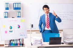 The male sales analyst in front of the whiteboard. Male sales analyst in front of the whiteboard stock photography