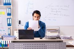 The male sales analyst in front of the whiteboard. Male sales analyst in front of the whiteboard royalty free stock images