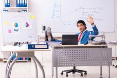 The male sales analyst in front of the whiteboard. Male sales analyst in front of the whiteboard royalty free stock photos
