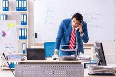 The male sales analyst in front of the whiteboard. Male sales analyst in front of the whiteboard royalty free stock photography