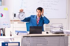 The male sales analyst in front of the whiteboard. Male sales analyst in front of the whiteboard royalty free stock photo
