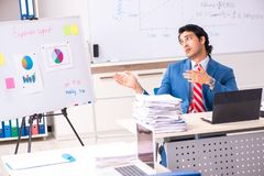 The male sales analyst in front of the whiteboard. Male sales analyst in front of the whiteboard royalty free stock image