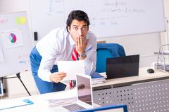 The male sales analyst in front of the whiteboard. Male sales analyst in front of the whiteboard stock photo