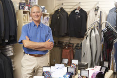 Male sales assistant in clothing store Royalty Free Stock Images