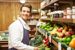 Male Sales Assistant At Vegetable Counter Of Farm Shop Stock Photography