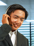 Male Sales Representative Talking On A Headset. Male Sales Representative In His Office Talking On A Headset To A Customer Royalty Free Stock Photos