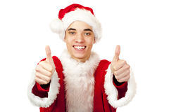 Male santa claus teenager shows both thumbs up Royalty Free Stock Image