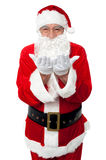 Male santa posing with open palms. Cheerful santa posing isolated over white Stock Photo